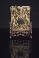 *A Chinese tortoiseshell-mounted pierced jade table screen, 18th/19th century