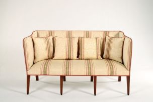 An Edwardian mahogany and upholstered settee