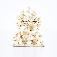 A Japanese ivory okimono group, Meiji Period (1868-1912)