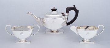 A three-piece George VI silver tea set, Ernest W Hayward, Birmingham, 1937