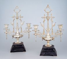 A pair of Victorian silver-plate two-light candelabra