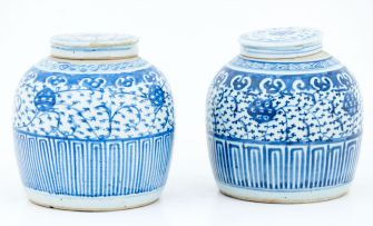 A pair of Chinese blue and white jars and covers, 19th century