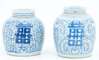 A near pair of Chinese blue and white jars and covers, 19th century