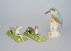 A pair of Halcyon Days figures of recumbent greyhounds, modern