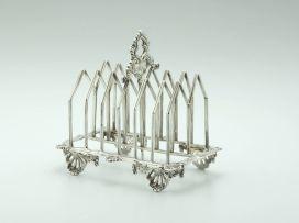 An early Victorian silver toast rack, Benjamin Davis, London, 1839