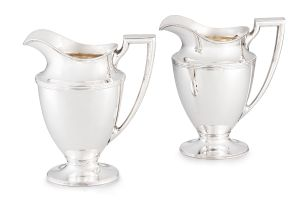 A near pair of Tiffany & Co silver water pitchers, 1907-1947, .925 sterling