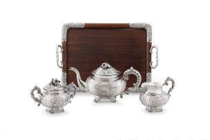 A Chinese Export silver three-piece tea service, Wo Shing, Shanghai, circa 1830-1875