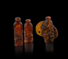 Three Chinese amber snuff bottles, early 20th century