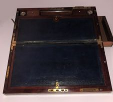 A Victorian mahogany and brass-bound travelling lap desk