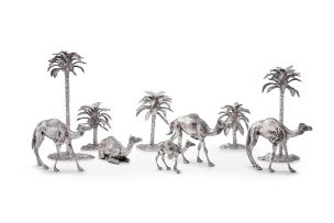 A silver 'Date Palm' candelabra and camel table setting, Patrick Mavros, Harare, 2006-2007
