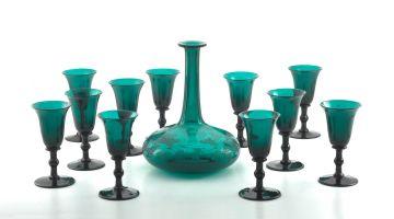 A set of eleven Victorian green-glass wine glasses