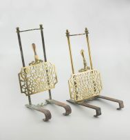 A pair of brass and iron grate trivets, 19th century