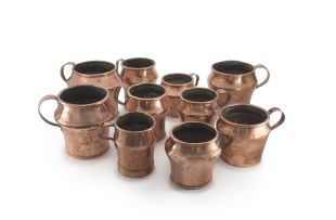 A group of ten copper koshering vessels, 19th/20th century