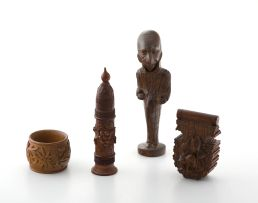 A carved wooden pipe stopper and stand, late 19th/early 20th century