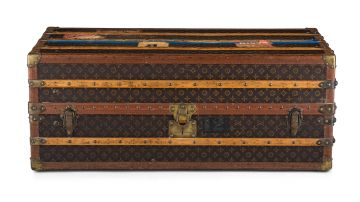A Louis Vuitton wood and leather cabin trunk