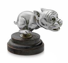 A nickel-plate Telcote pup mascot, Bonzo, British, 1930s