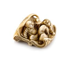 An ivory netsuke of a reveller and his attendant, 19th century