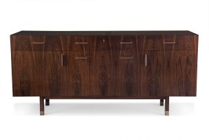 A Danish rosewood and maple-lined sideboard designed in the 1960s by Axel Christiansen Odder for ACO Møbler