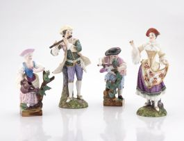 A pair of figurines of gardeners, late 19th century