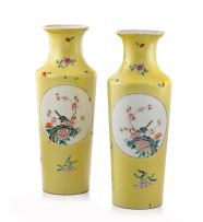 A pair of Chinese yellow sgraffiato ground and famille-rose vases, late Qing/early Republic period
