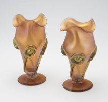 A pair of Art Nouveau iridescent orange glass vases, possible Loetz