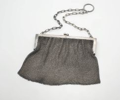 A George V silver chain mail handbag, with retailer's initials G & C, with import marks for Birmingham, 1910, .925 sterling