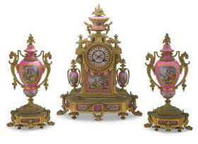 A French 'Sèvres' porcelain and gilt-bronze mounted clock garniture, circa 1850