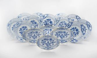 An assembled set of Meissen reticulated blue and white 'Blue Onion' pattern plates and dishes, late 19th/early 20th century