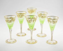 A set of six pale green and gilt flutes, 19th century