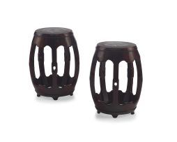 A pair of Chinese hongmu and marble inlaid drum stools, Qing Dynasty, 19th century