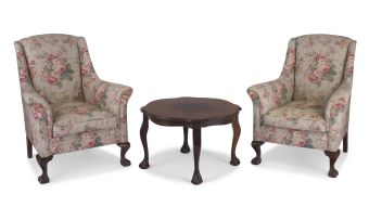 A pair of upholstered imbuia ball-and-claw armchairs, 20th century