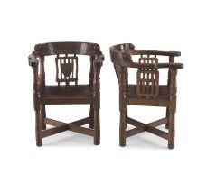 A pair of Robert 'Mouseman' Thompson of Kilburn oak armchairs, 1928
