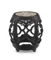 A Chinese carved hardwood and porcelain drum stool, Qing dynasty, 19th century