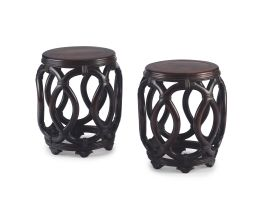 A pair of Chinese hongmu and walnut inlaid drum stools, Qing Dynasty, 19th century