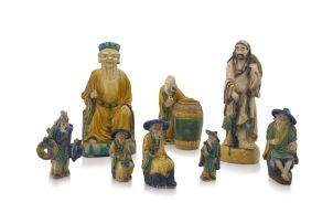 A group of eight Chinese sancai-glazed stoneware figures of sages and tradesmen, 20th century