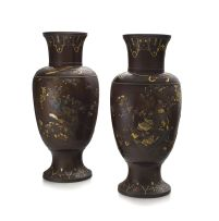 A pair of Japanese shakudo and silver overlaid bronze vases, Meiji period 1868-1912