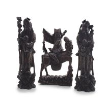 A pair of Chinese hardwood and silver-inlaid figures of Shou lao, early 20th century
