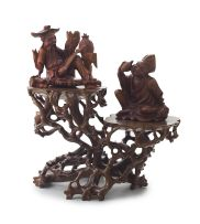 A Chinese hardwood two-tiered stand, late Qing Dynasty, 19th century