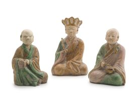 Three Chinese Ming style sancai-glazed stoneware figures of two monks and a deity, 20th century