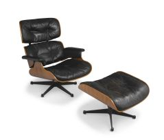 A leather and rosewood-veneered model 670 lounge chair and 671 ottoman designed in 1956 by Charles and Ray Eames