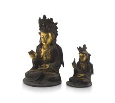 A Chinese parcel-gilt bronze figure of Guanyin, Ming Dynasty, 1636-1644