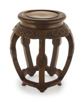 A Chinese huanghuali barrel-form stool, Qing Dynasty, 19th century