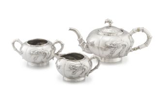 A Chinese Export silver presentation three-piece tea service, Kwong Hing Loong & Company, 1880-1920