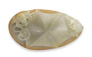 A Chinese celadon jade pendant, Qing Dynasty, 19th century