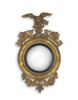 A George IV giltwood convex mirror