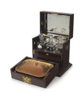 An Edwardian mahogany and satinwood marquetry inlaid travelling games and tantalus