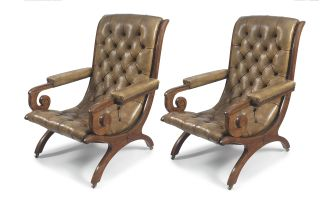 A pair of walnut and leather-upholstered armchairs, late 19th century