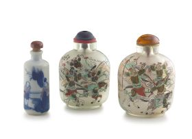 A pair of Chinese reverse painted glass snuff bottles, 20th century