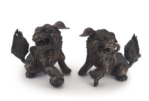 A pair of Chinese bronze dogs-of-fo, Qing Dynasty, 19th century