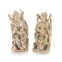 A pair of Chinese carved ivory figures of warriors, Qing Dynasty, 19th century